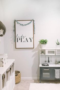 ' Let's Play' Printable, modern play kitchen, baskets for kids toys. ' Let's Play' Printable, modern play kitchen, baskets for kids toys. Playroom Design, Playroom Decor, Baby Room Decor, Office Playroom, Modern Playroom, Sunroom Playroom, Playroom Table, Modern Kids Bedroom, Kids Playroom Furniture
