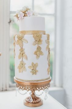 Unusual white cake with gold flowers