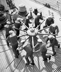 Students of Odessa maritime school use capstan to raise anchor, 1966