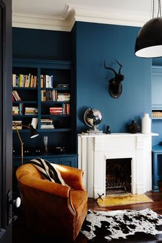 """When it comes to picking out the right shade of blue, Lambie believes the brighter the hue, the better. """"Rich blues tend to be our favorite because the color can change beautifully and dramatically throughout the day, depending on the light,"""" she says. Test your color out in a space with plenty of windows to discover its intensity at different times of day."""