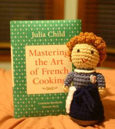 :) This is so cute, a little Julia Child next to the book that made her famous! This is also prefect for Julie and Julia fans. I use  to like watching her cooking show on PBS.