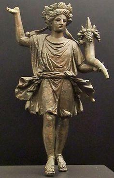 Lar bronze statuette of garlanded Lar holding cornucopia. Roman Seville 1st century CE.
