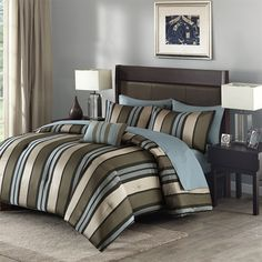 Create a cool, sophisticated look with the Boden 8 Piece Comforter Set by Madison Park.  The comforter and shams feature a jacquard woven striped design in shades of brown, ivory, and blue for classic elegance.  A decorative pillow completes the set.  Includes 1 flat sheet, 1 fitted sheet, and 2 pillowcases.