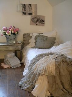 I love this fancy, frilly, textured bed. And the fresh flowers in a bucket. And the curved wall to ceiling.
