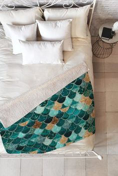 Make waves in your home with a bold green and gold fleece mermaid scale throw blanket.