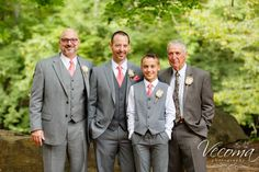 Light gray suits with coral ties