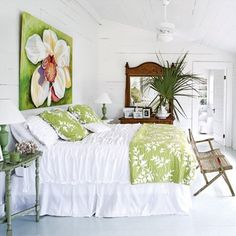 Love this beach house style bedroom! Love the white with the touches of green!