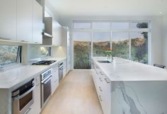 Image 10 of 15 from gallery of Black Magic House / Rowland+Broughton Architecture. Photograph by Brent Moss Latest Kitchen Designs, Clad Home, Magic House, Light Hardwood Floors, Architectural Section, Large Windows, Bathroom Interior Design, Black Magic, Interiores Design