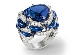Ohhh...... Chaumet Lumieres d'Eau high jewellery ring in white gold, set with a 16.50ct troidia-cut tanzanite, round sapphires, lapis lazuli and brilliant-cut diamonds.