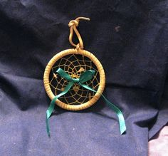 Dream Catcher Leather wrapped white green. $10.00, via Etsy.