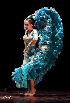 Luisa Palicio, a great elegant dancer from the school of Seville. She has amazing bata de cola technique. photo credit Jose Luis Gordillo López