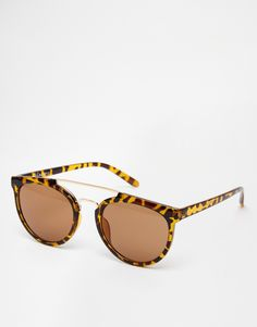 Sunglasses by AJ Morgan Lightweight frames with a double bridge design Moulded nose pads for added comfort Dark tinted lenses Slim arms with curved temple tips for a secure fit Total UV protection