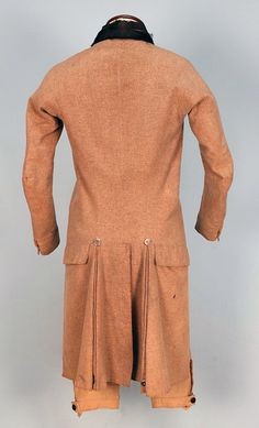 GENT'S EVERYDAY WOOL COAT and BREECHES, 1800-1820. Oatmeal double breasted cutaway style with velvet collar, steel buttons, rear flap pockets, back vent flanked by stitched down pleats having top and bottom button detail, glazed linen lining. Ch-36, W-34, Sh-15, Slv- 24.