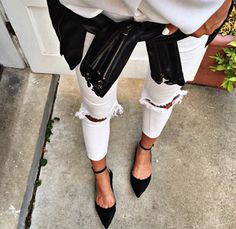 We love this pairing of black and white pieces. Get the look with white ripped jeans, a leather jacket, and black strappy flats.