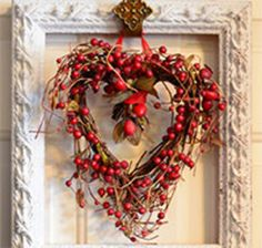 You can make this Valentines door hanging by using any frame (no glass or back) and hanging an object in it. It takes 5-10 minutes to put together.I found the