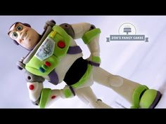 In this cake topper tutorial we will be making Buzz Lightyear from the Toy Story movies! I used Laped modelling paste to create the figure but you can use wh. Toy Story Cake Toppers, Toy Story Cakes, Toy Story Movie, Toy Story Buzz, Cake Topper Tutorial, Fondant Tutorial, Zoes Fancy Cakes, Disney Themed Cakes, Toy Story Figures