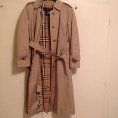 Burberry tan trench coat . Vintage Burberrys tan trench coat . Button down coat. Some wear on the buckles of belt and on arms. Doesn't have size fits S/M. Last picture shows minor stain from cleaning on back of coat not very noticeable. Great condition ✨ Burberry Jackets & Coats Trench Coats