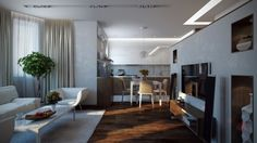 A soft white sofa and gorgeous natural wood floors are beautiful features in this fully feminine apartment.