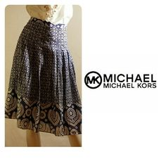 Michael Kors Skirt Perfect summer skirt in blue and white Moroccan floral print. Figure flattering demi pleated skirt. Worn once. Excellent condition. Side zipper and fully lined. 100% cotton. Waist 14.5, 26.5 lenght MICHAEL Michael Kors Skirts Midi
