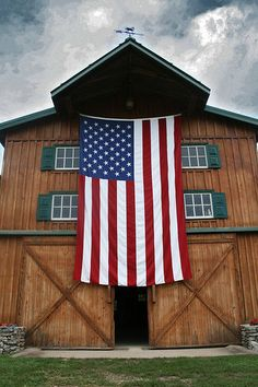 """An American flag hangs from a barn in Oklahoma"""