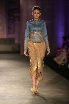 saree as dhoti paired with a smart jacket