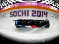 Thibault Alexis Godefroy of France pilots a run during a four-man bobsleigh practice session at Sliding Center Sanki. Sochi 2014 Day 13 - Bobsleigh Women's Heat.