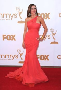 Vera Wang coral one-shouldered crepe gown, Casadei heels and Lorraine Schwartz jewelry . CoverGirl makeup - Sofia Vergara - 63rd Primetime Emmy Awards 2011