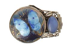 George Hunt. Silver, enamel and agate dress clip brooch. Sold by Bonhams.