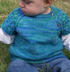 """Free Knitting Pattern for Lace Sleeved Baby Pullover - This baby sweater """"HINE is a Girl"""" by Kelly van Niekerk features beautiful lace leaf short sleeves and buttons at the yoke for easy dressing. Great for layering or by itself in warm weather. Size 18-24 months. Pictured project by cadilily"""