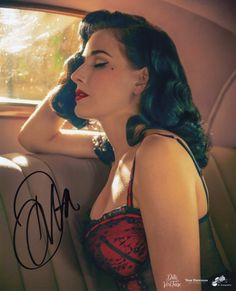 Autographed portrait • Signed by Dita Von Teese • Printed on Kodak Professional Endura lustre paper • 8 x 10 inches Open Edition Authentic edition rubber stamp on verso • Hand-signed letter of authent