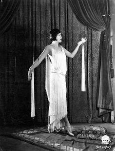 Model Cecilia Evan in a gown by Travis Benton,1925