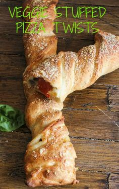 Veggie Stuffed Pizza Twists the perfect alternative to pizza! Loaded with veggies and 2 types of cheese. Crunchy on the outside. Perfect quick and easy meal/anitalianinmykitchen.com