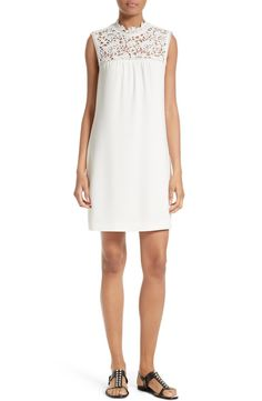 This is the season to switch out the usual LBD for the fresher look of a little white dress, this one of fluid crepe with a demure yoke of embroidered lace.