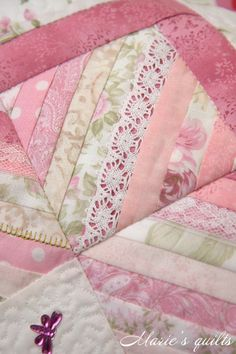 Marie's quilts. I love the lace overlay on some of the strips.