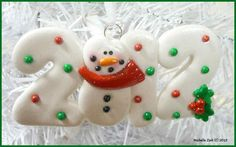 Polymer Clay Ornament 2012 Snowman  Click on the image. Awesome ornaments made out of polymer clay!
