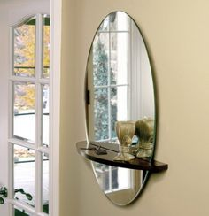 Hall mirror set into the slit in the wood! Great idea!