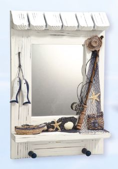 Nautical decor for your bathroom can include customizing your mirror with drift wood.