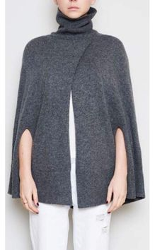 Knitted cape with rib roll neck armhole opening and front overlap in a classic grey marle. This timeless style is beautiful and soft to wear in a wool and cashmere blend.  Wool Cashmere Cape by Elka Collective. Clothing - Sweaters - Ponchos & Capes Victoria Australia