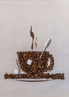 Coffee beans in a cup, spoon and sugar - Coffee beans in a cup, spoon and sugar