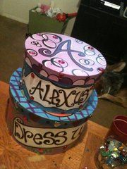 we just painted these hat boxes and filled them with dress up clothes