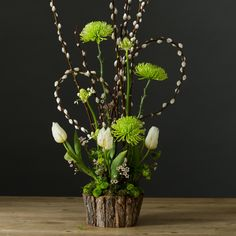 First Shoots Flower Arrangement for Spring White Tulips, Wax Flower, Salix Pussy Willow and green chrysanthemums.
