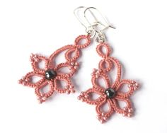 Tatted lace earrings, salmon pink tatting, sterling silver ear wires. $22.00, via Etsy.