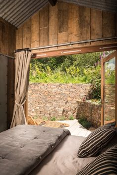 En suite bedroom with bi-fold doors that open onto a private secluded deck
