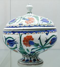 Lidded bowl with cypresses, carnations, and other flowers.between circa 1560 and circa 1580.stone-paste; glaze on painted decoration.
