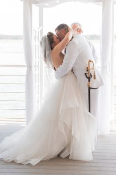 Bride and groom share their first kiss as husband and wife on their wedding day at the Lesner Inn in Virginia Beach || Elizabeth Henson Photography