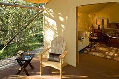 Pinnacle Camp - deck with comfortable Adirondak chairs.  Beautiful tub in bedroom.