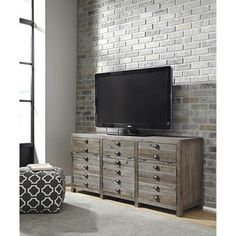 Shop for Signature Design by Ashley Keeblen Grayish Brown Extra Large TV Stand…