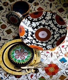 From top: Background of Kathryn M. Ireland's Safi Suzani linen. Mosaic cloisonné box, Mosaic cloisonné bowl, and Suzani Design large cloisonné box, all from Tozai Home. Antique brass tray from ABC Carpet & Home. Silverware by Roberta Roller Rabbit. Asian Inspired Decor, Asian Interior, Arte Popular, Plates And Bowls, Decoration Table, Inspired Homes, Elle Decor, Ceramic Pottery, Boho Decor