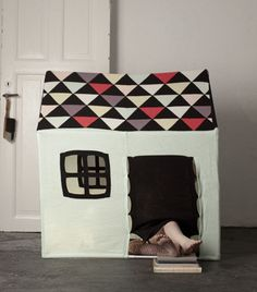 playhouse... my friend gave me two little cardboard houses, cloth and felt will be perfect for it.