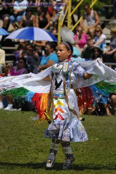 Stock Photo titled: Young Native Indian Girl On Toes In The Fancy Shawl Dance Competition At The Grand River Pow Wow, unlicensed use prohibited